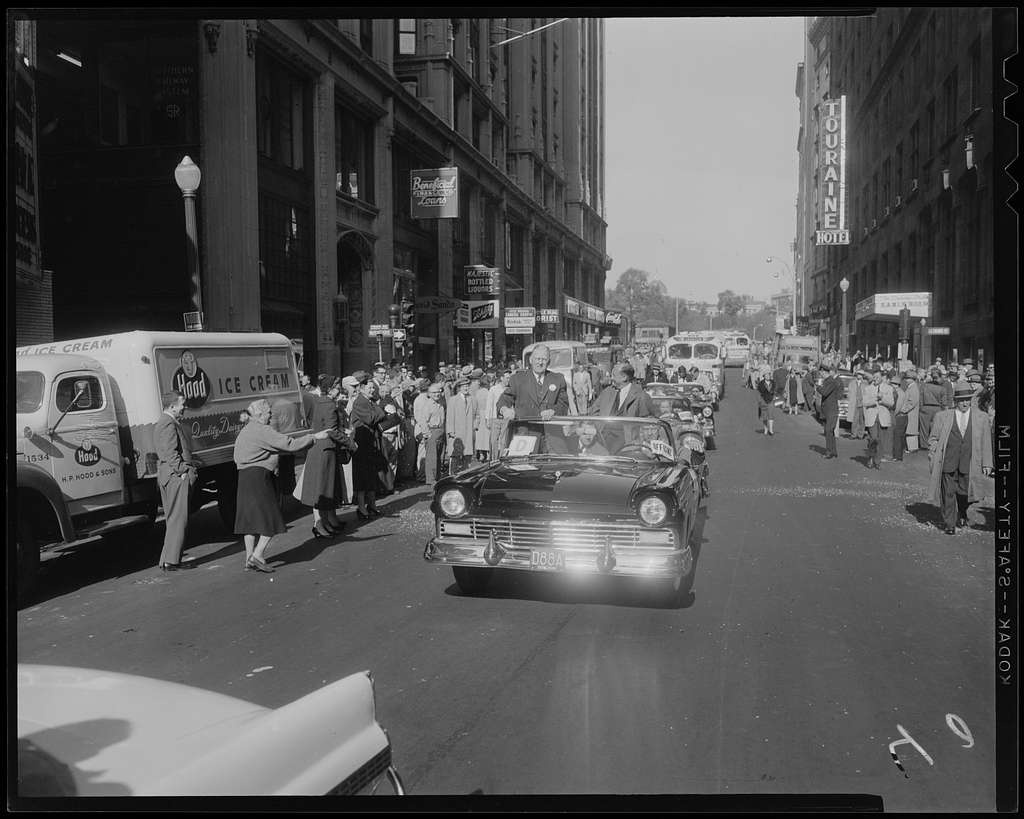 Mayor John B. Hynes and Adlai Stevenson sitting in the front car during a parade