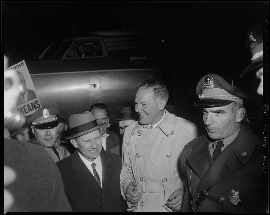 Henry Cabot Lodge, Jr. with others, shortly after his plane's arrival at Beverly airport