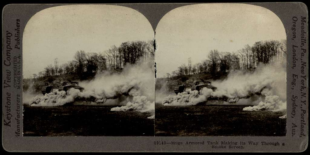 Huge armored tank making its way through a smoke screen